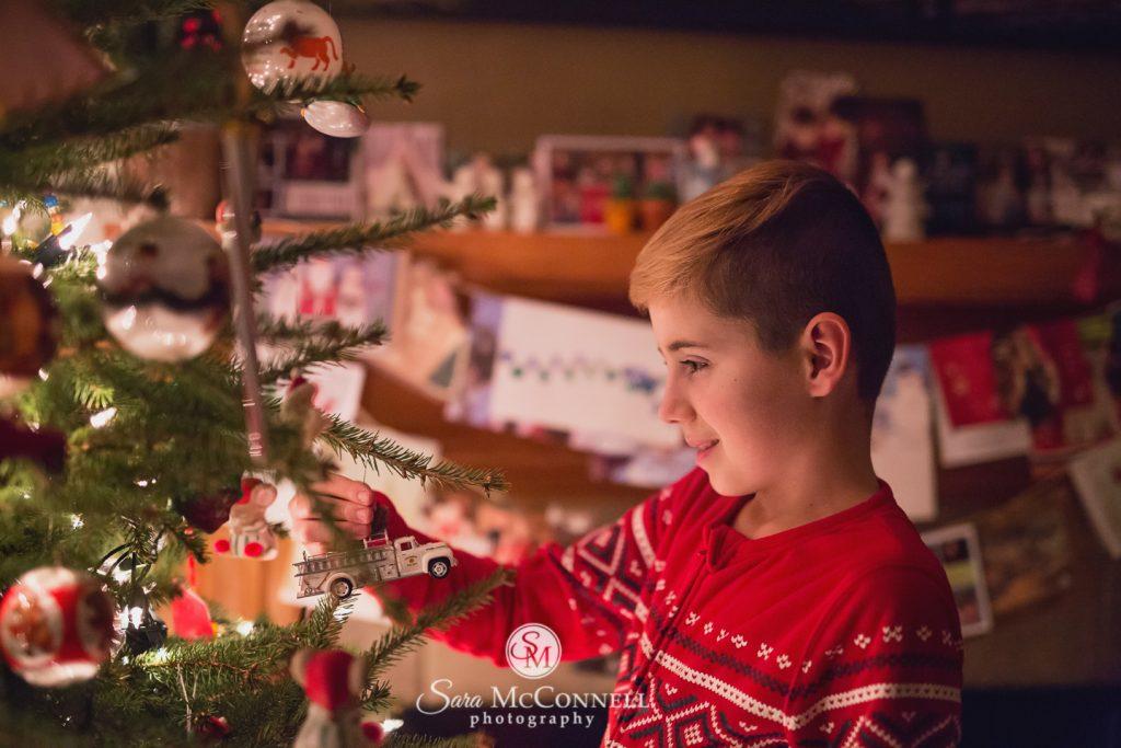 teenager decorating the christmas tree