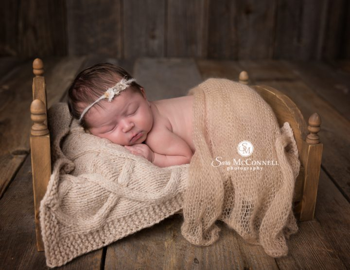 Ottawa Newborn Photographer | Sleeping in a wooden bed