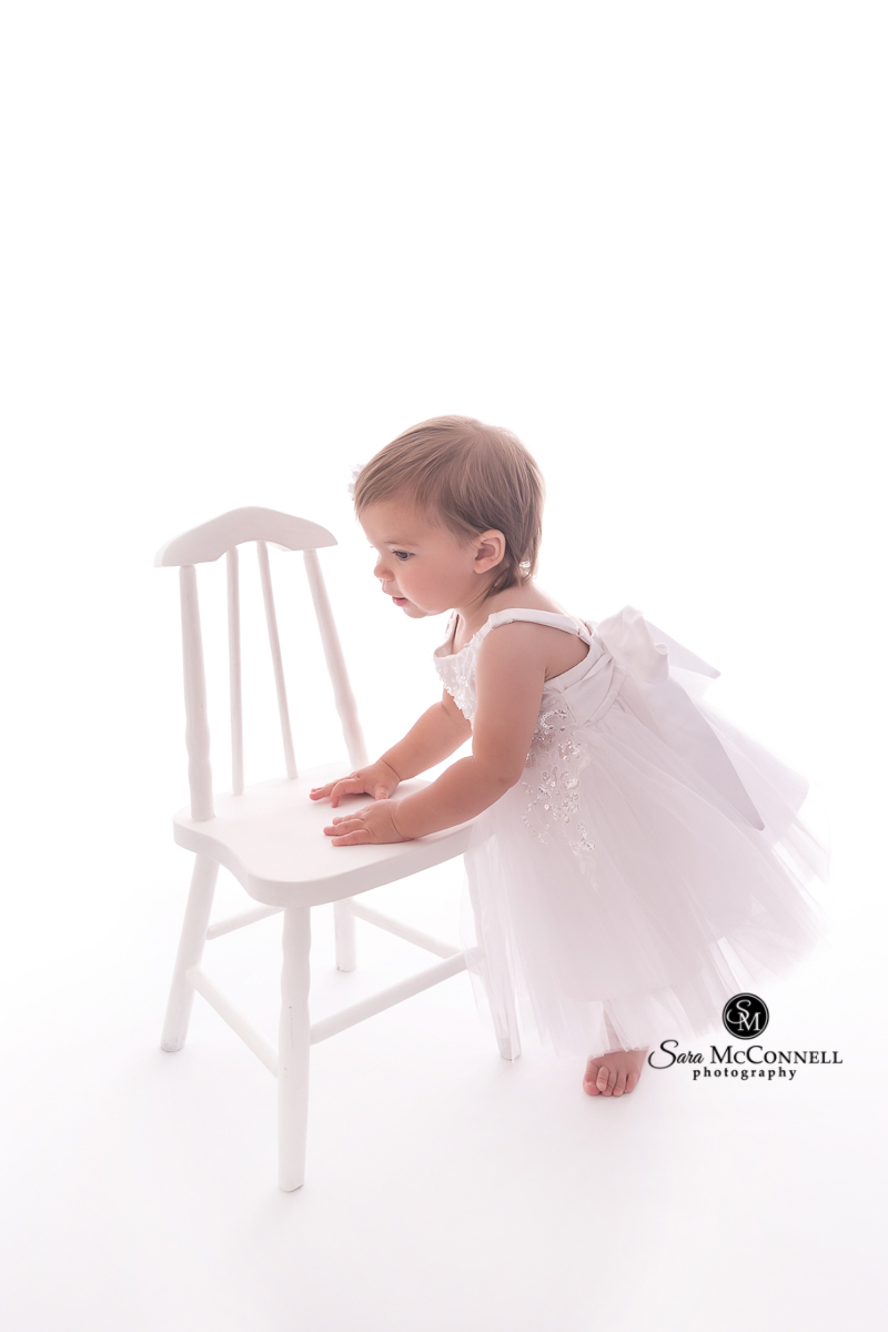Little girl celebrating her first birthday - photos by Sara McConnell Photography