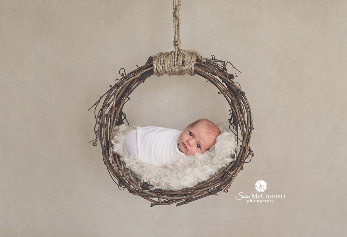 Ottawa newborn photos by Sara McConnell Photography - baby in a wreath