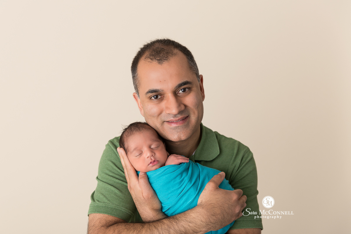 Ottawa Newborn Photo - father holding Newborn baby