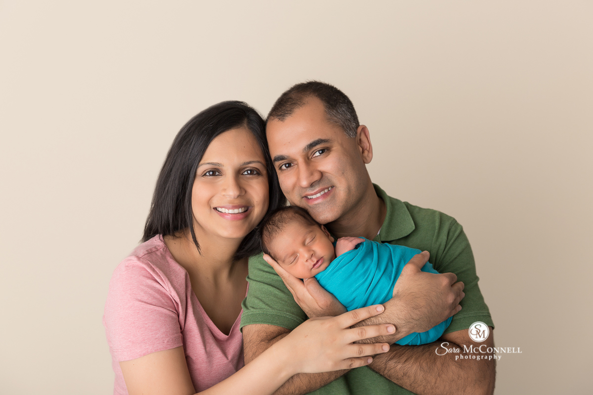 Ottawa Newborn Photo -father and mother holding Newborn baby