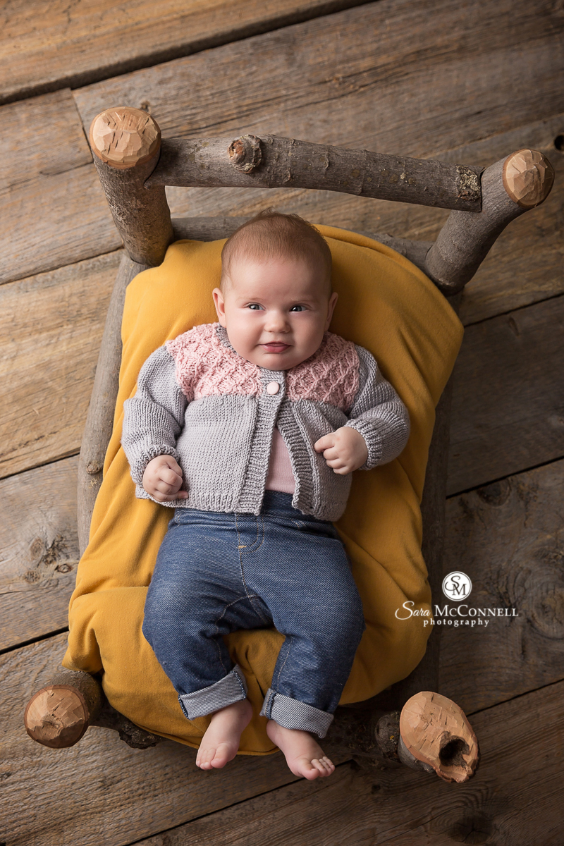 Baby photos with an Autumn colour scheme and set design