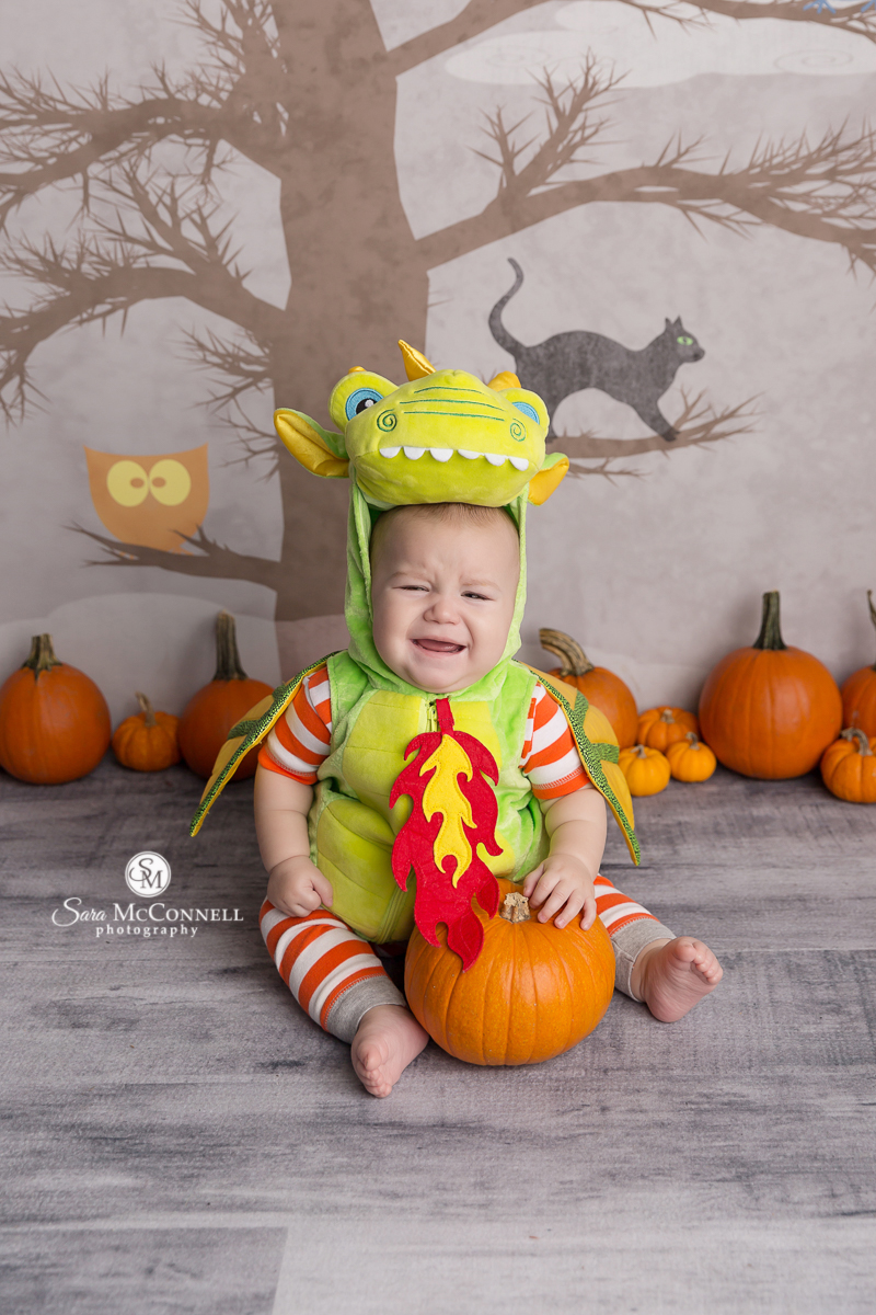 Baby dressed as a dragon