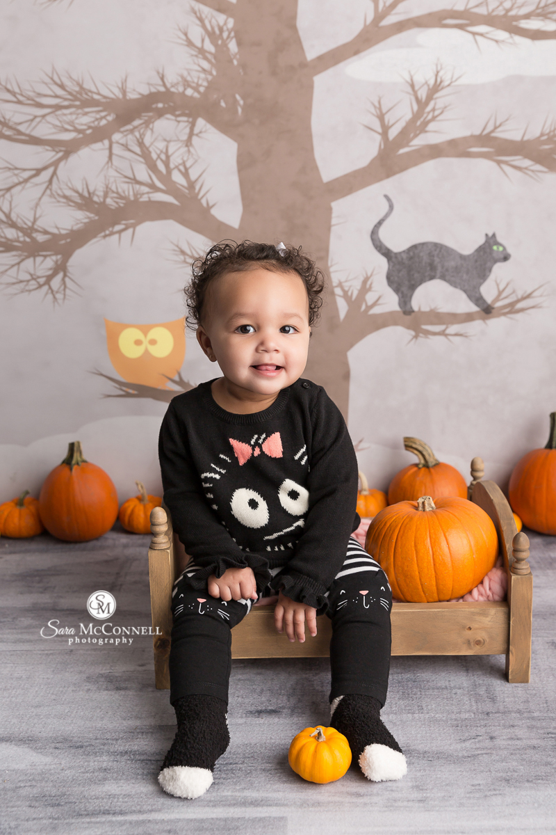 Baby smiling for a Halloween photo