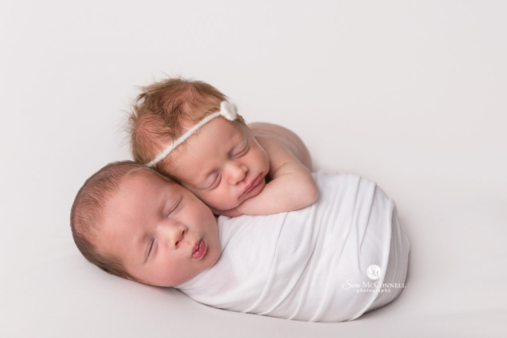 sleeping newborn babies - one wrapped in white