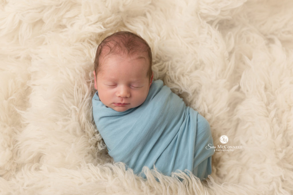 newborn wrapped in blue