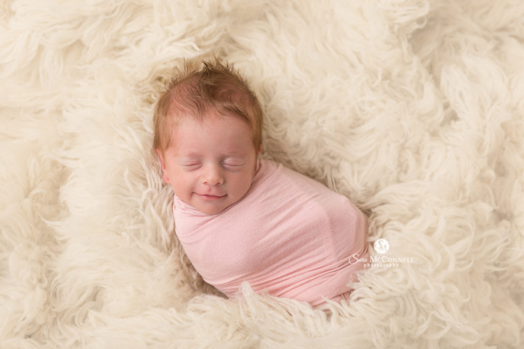 newborn wrapped in pink