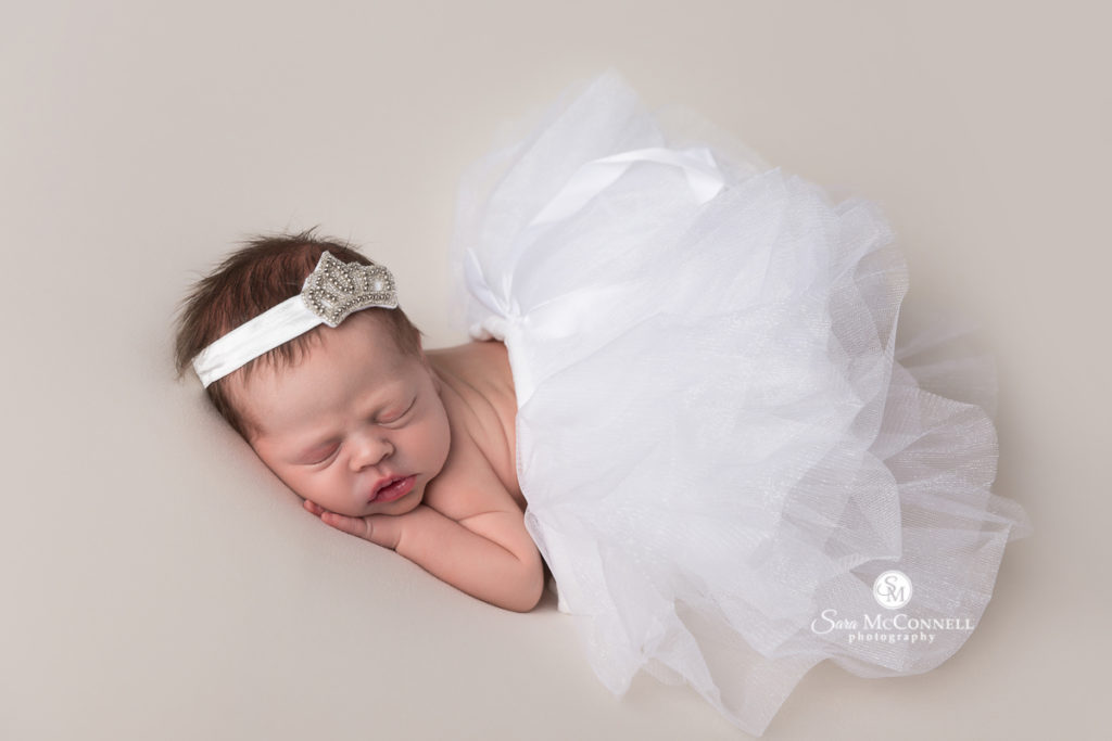 Newborn baby wearing white tulle