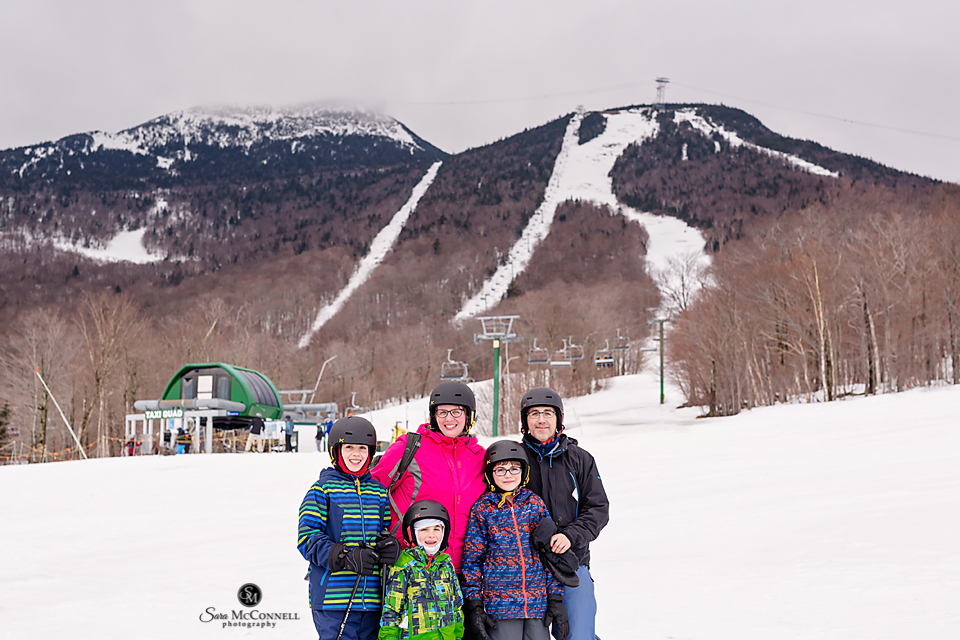 Sara McConnell, her husband and her three sons standing at the bottom of a ski hill