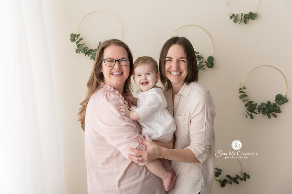 mothers holding baby  for Mother's Day photos with Sara McConnell Photography