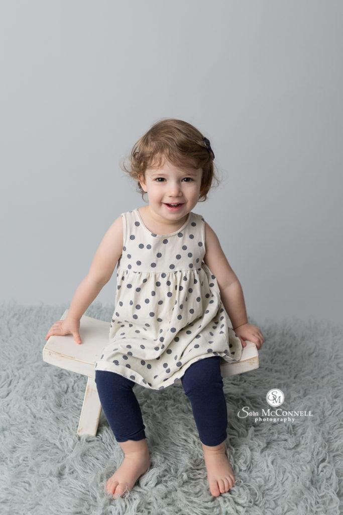 young girl wearing a polka dot dress