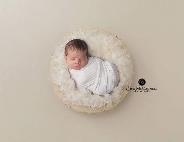 Ottawa Newborn Photographer | Snuggles on the bed