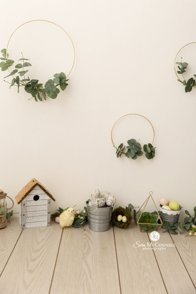spring decor, brass hoops on the wall with greenery