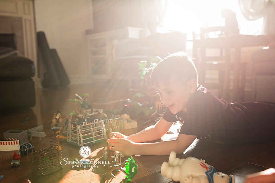 young boy playing with playmobil