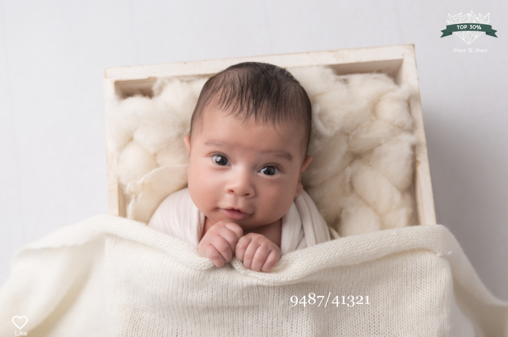baby in a wooden box