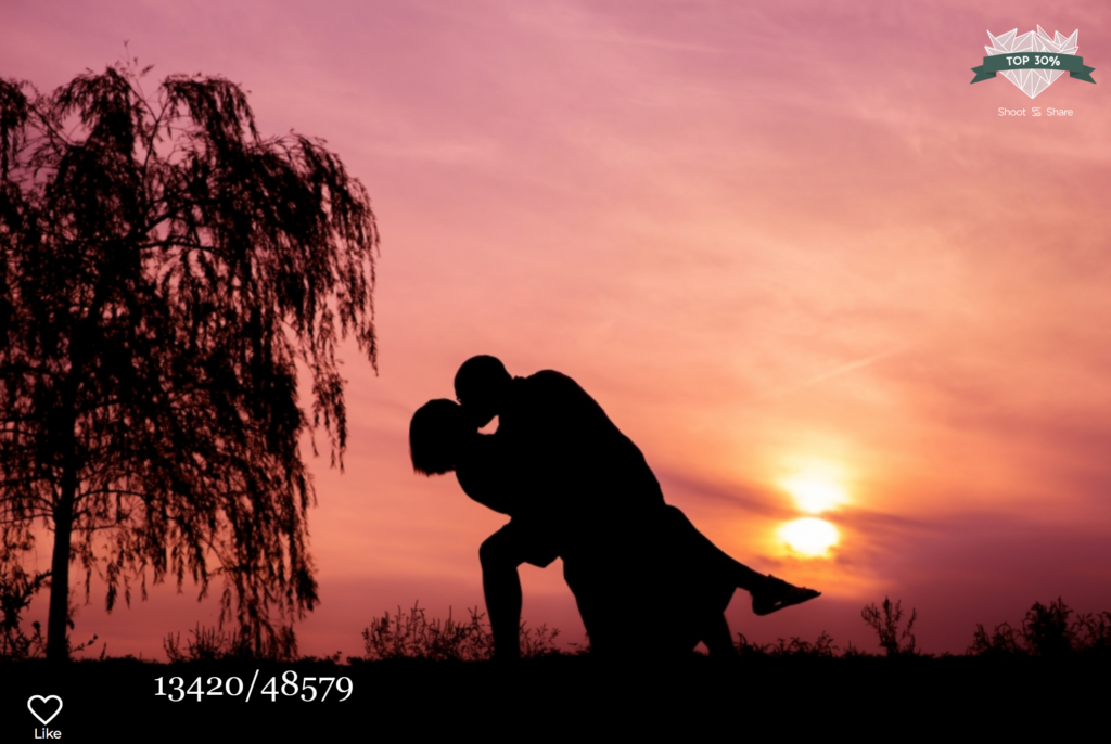 man kissing woman at sunset