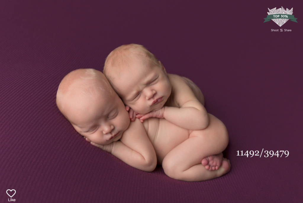 twins sleeping on a purple backdrop