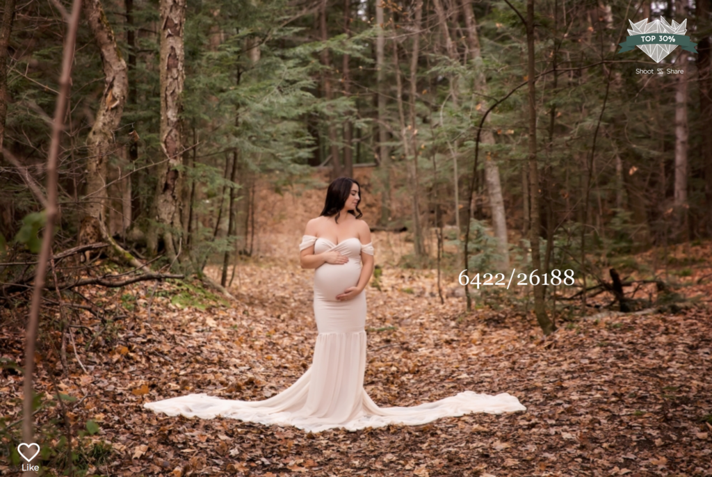pregnant women in a white gown in the forest