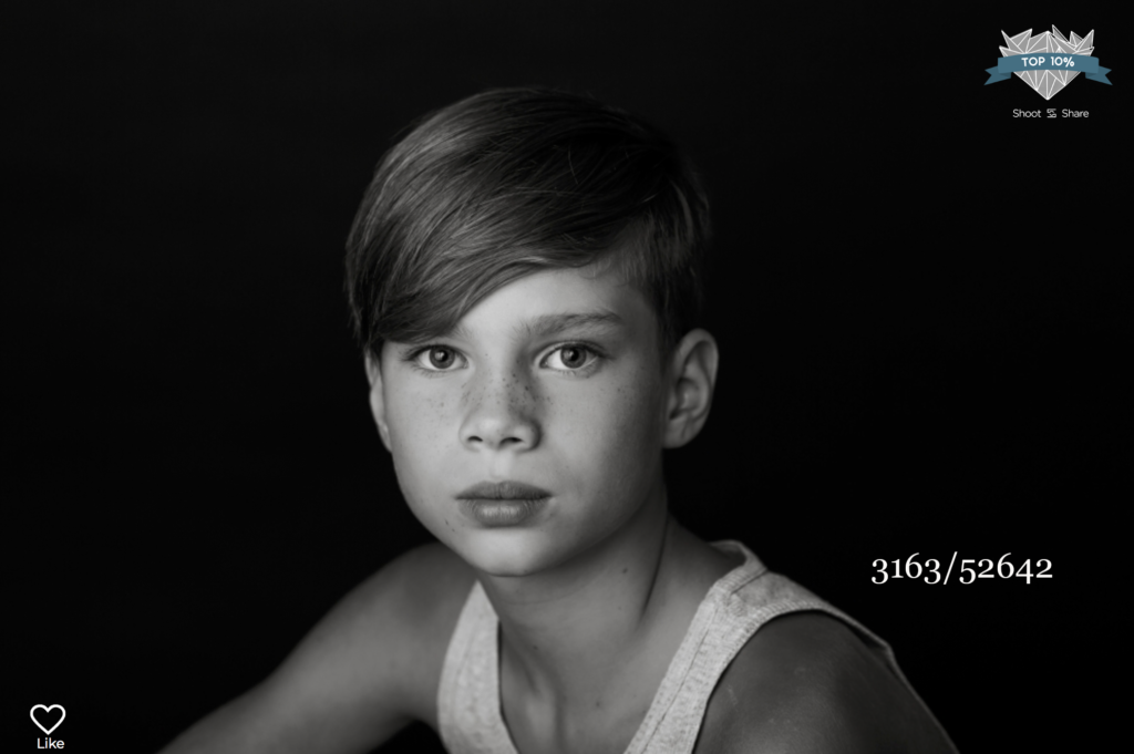 young boy looking at the camera by sara mcconnell photography