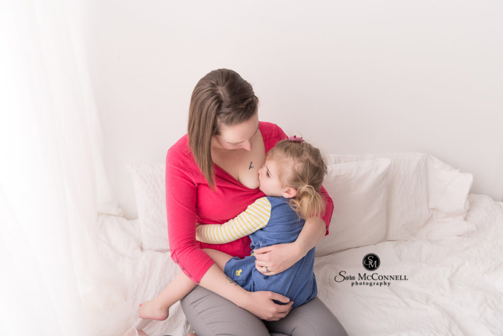 daughter breastfeeding during snuggle sessions