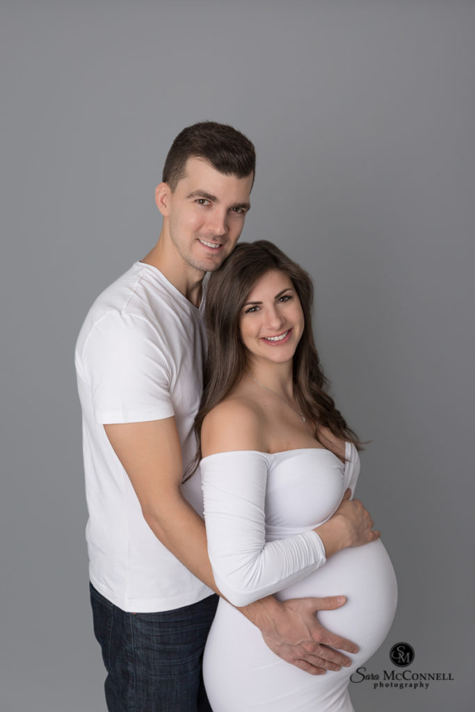 expectant couple taking maternity photos