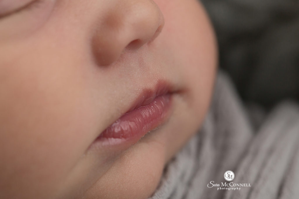 close up of newborn lips during newborn photo session