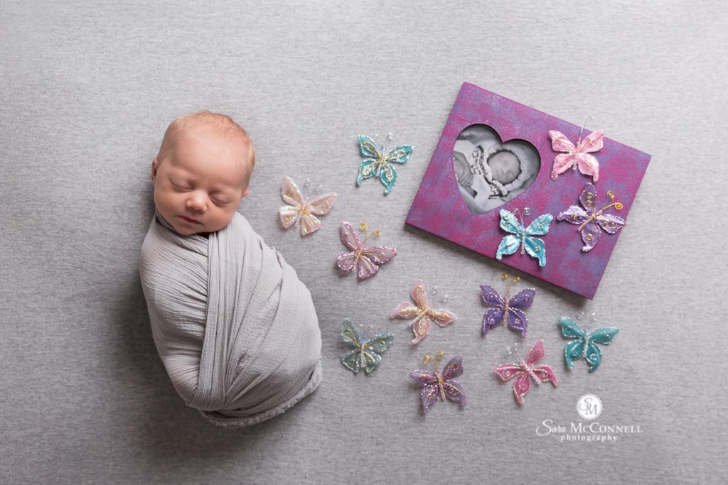 newborn baby sleeping with butterflies