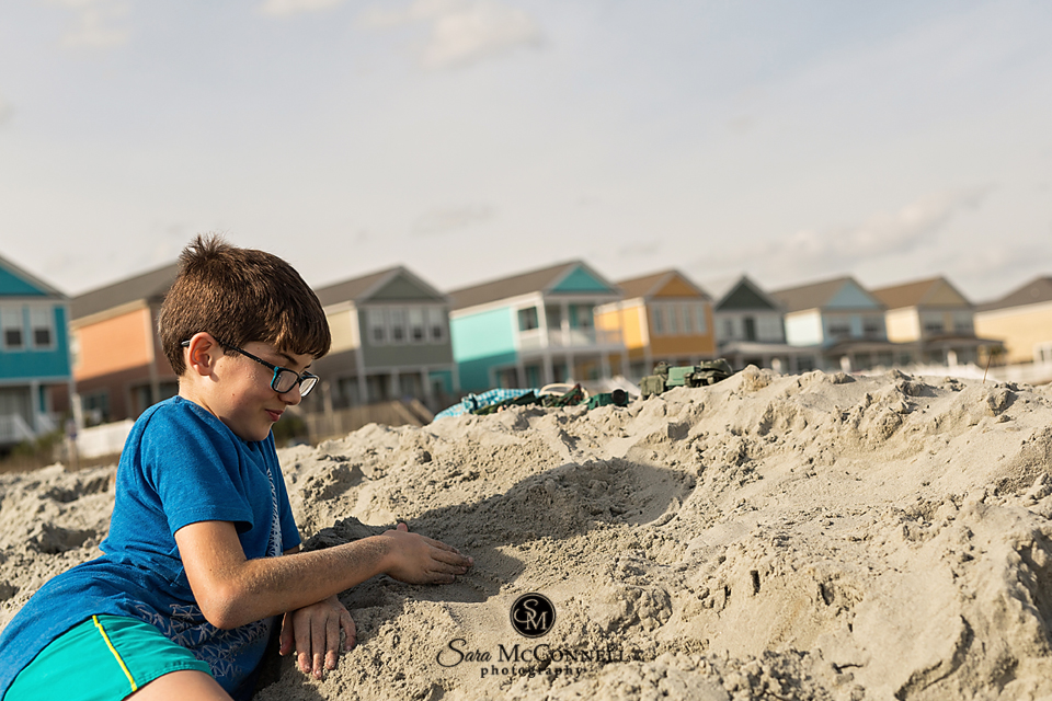 young boy building sand castles