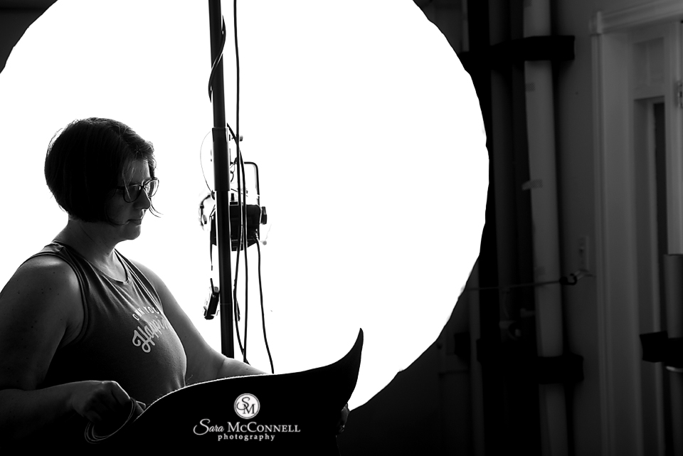 Sara McConnell setting up her studio lighting
