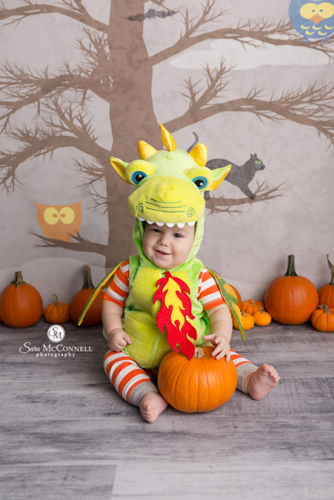 baby dressed as a dragon for halloween