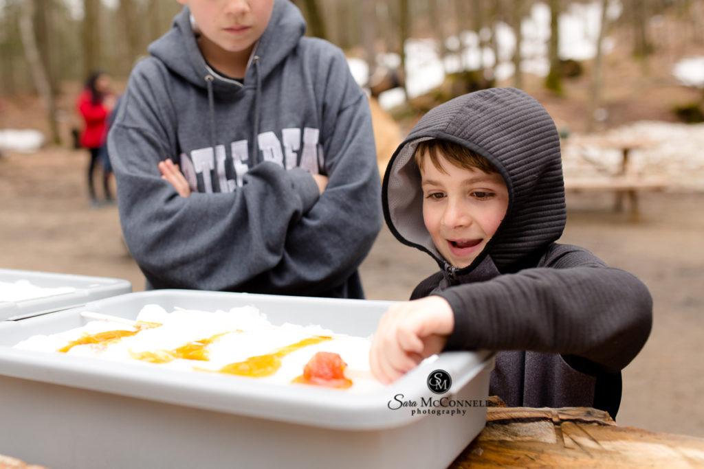 boy making maple taffy