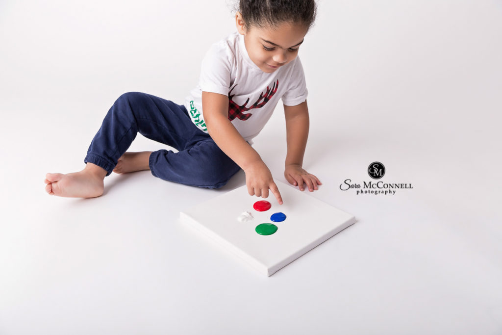 boy painting for her second birthday photos