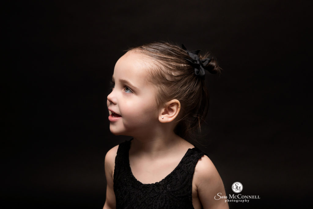 young girl looking away during family photos