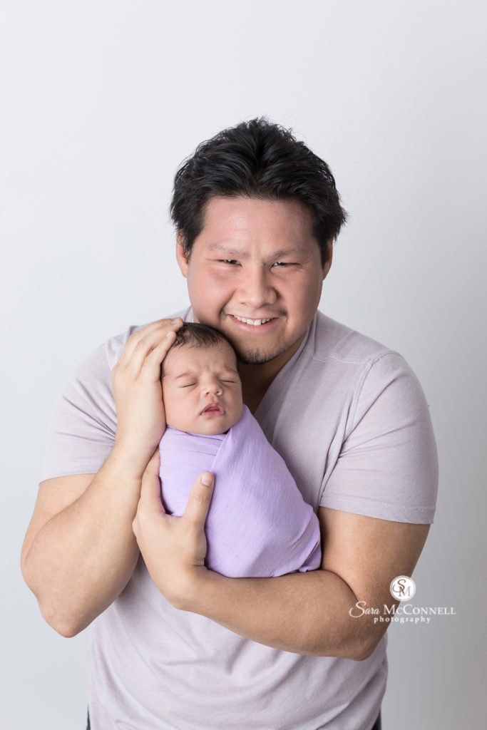 new dad with newborn baby