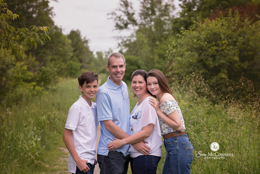 family of four in a field