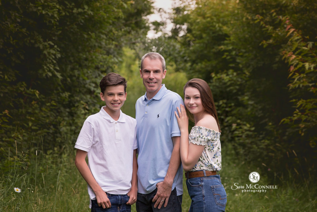 dad with his children for outdoor spring photos