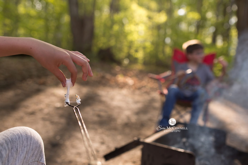 marshmallow toasting around a camp fire