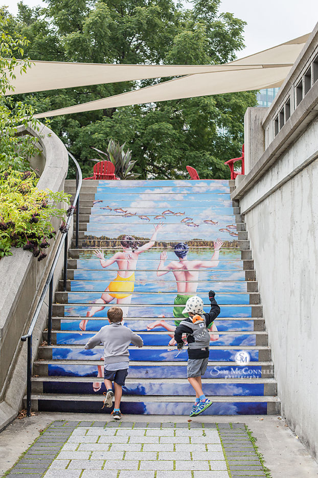 brothers climbing painted stairs