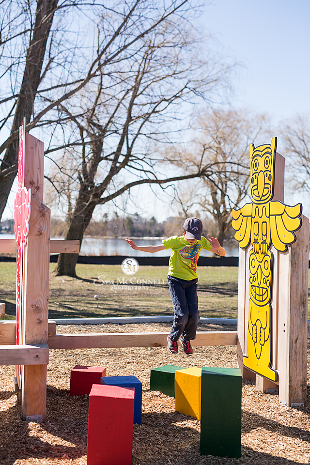 young boy playing at canada 150 park