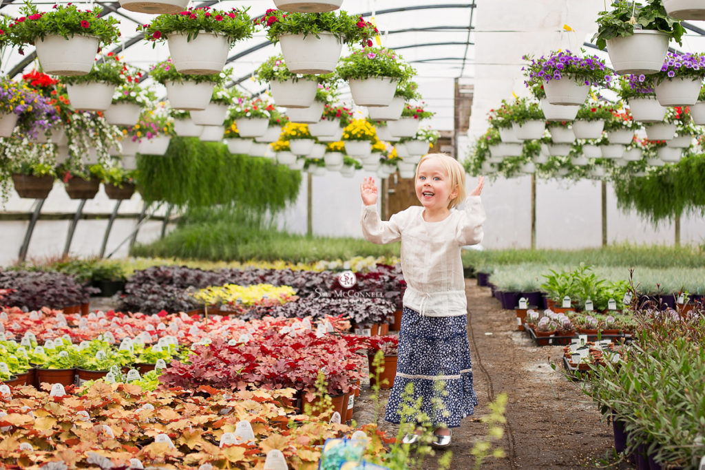 little girl in a green house