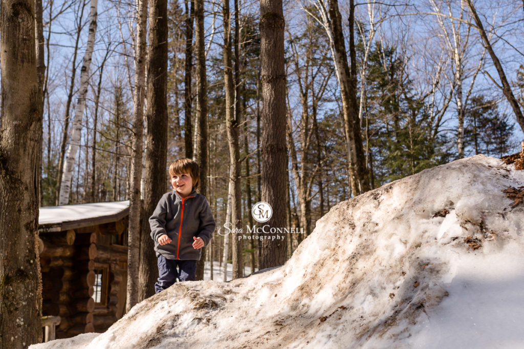 small boy in the snow at parc omega