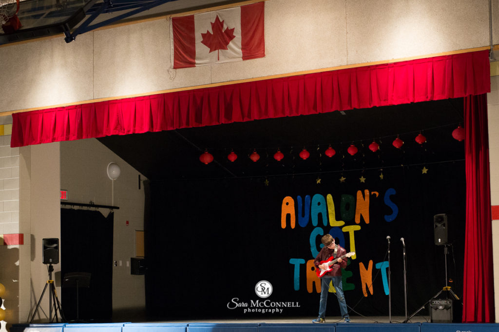 boy playing guitar at the talent show