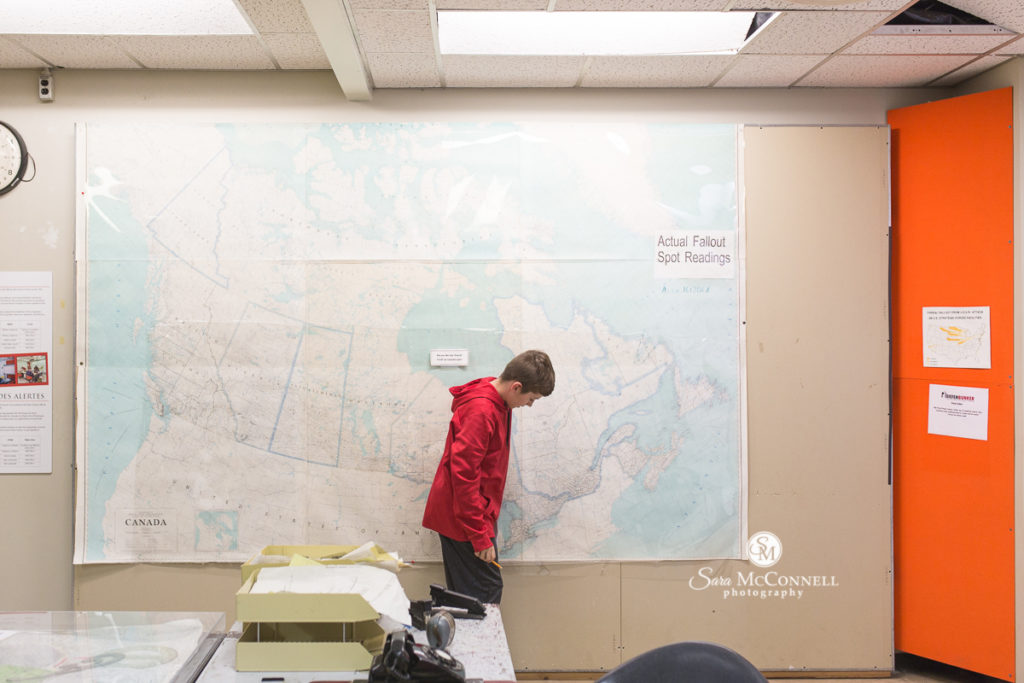 teen in front of a map at the diefenbunker museum
