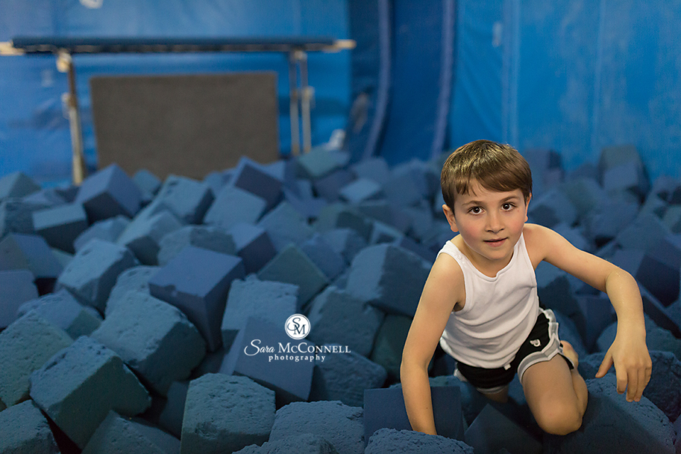 boy in tumble pit at gymnastics centre