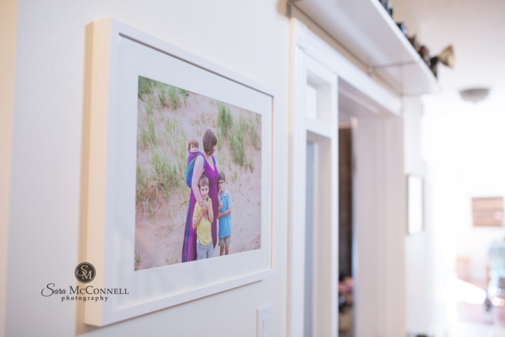 printed family photo in hallway