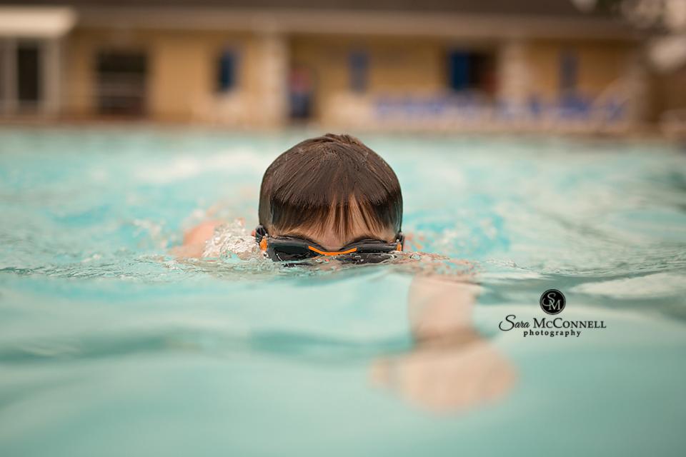 teen swimming in a pool