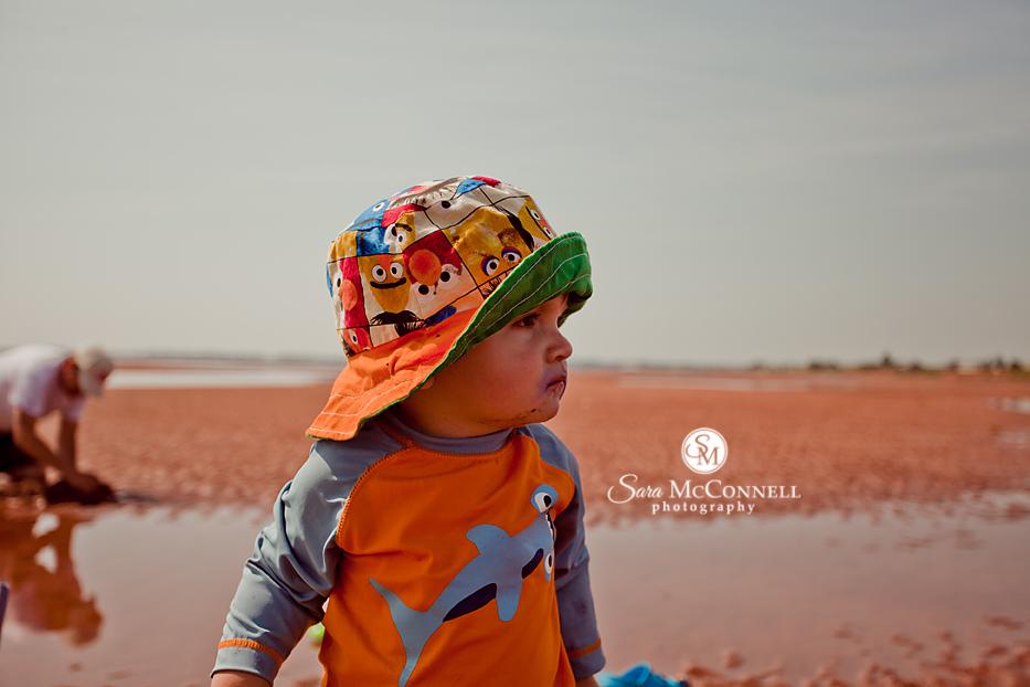 boy wearing a bucket hat on the beach