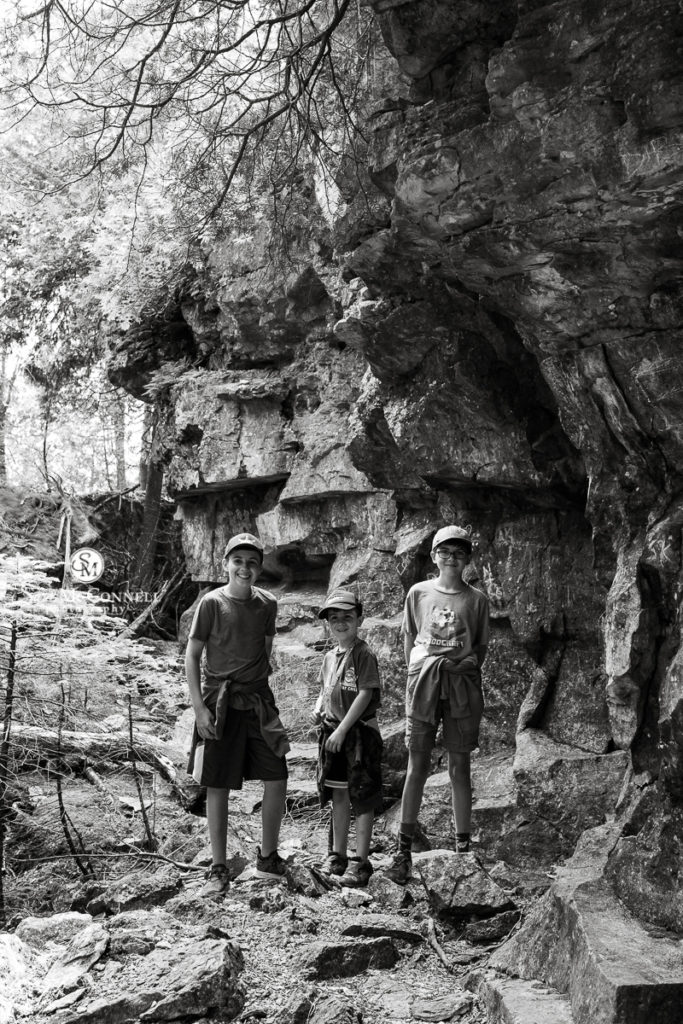 brothers walking among rocks and cliffs