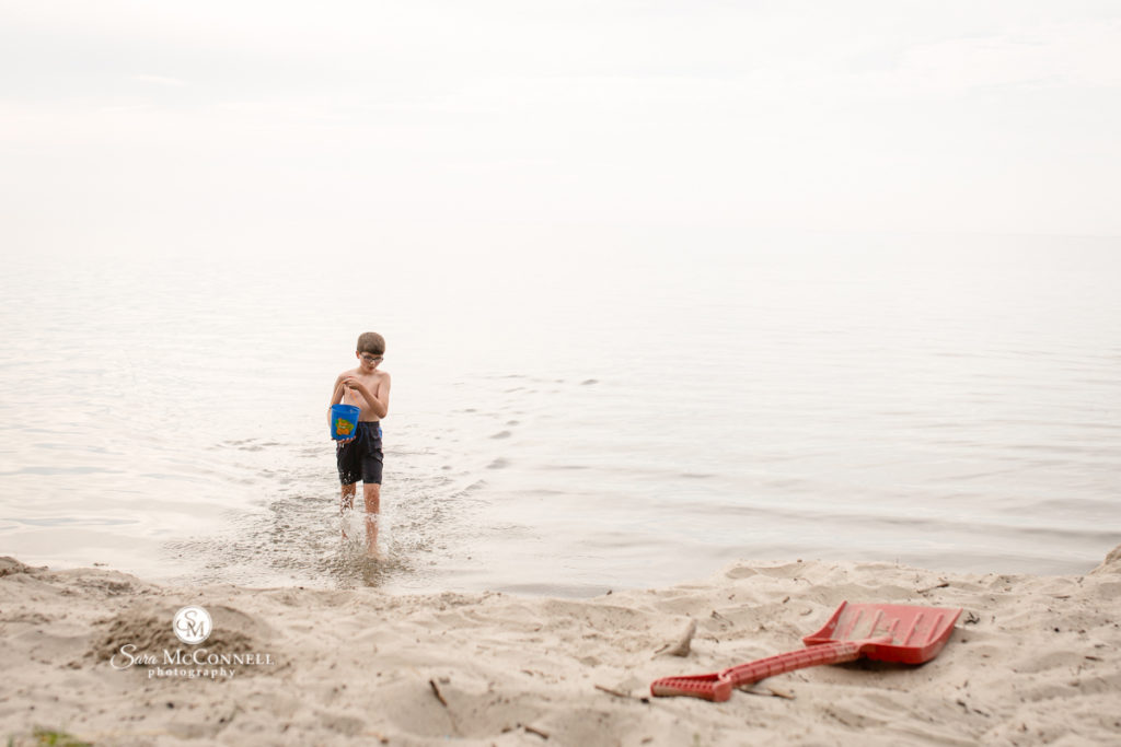 boy playing in the water at the beach